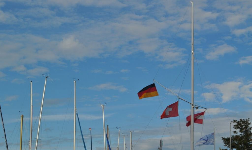 Swiss, German, and Austrian flags on a ship at Bodensee (Lake Constance)